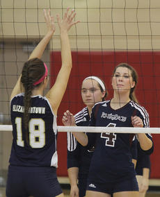"""<div class=""""source"""">Nick Schrager</div><div class=""""image-desc"""">Lady Knights senior right side hitter Nicole Mattingly and junior setter Jeni Hall look past Elizabethtown Panther senior middle hitter Shelby Priddy. </div><div class=""""buy-pic""""><a href=""""http://web2.lcni5.com/cgi-bin/c2newbuyphoto.cgi?pub=015&orig=11-06_volleyball_pic_3.jpg"""" target=""""_new"""">Buy this photo</a></div>"""