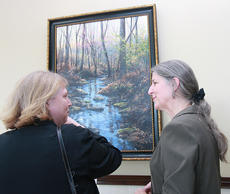 "<div class=""source"">Stephen Lega</div><div class=""image-desc"">Darlene Kelly, left, and Angela Selter chat in front of the painting ""Forest Clearing"" by Michael Wheeler. This is one of several pieces on display at the judicial center.</div><div class=""buy-pic""><a href=""http://web2.lcni5.com/cgi-bin/c2newbuyphoto.cgi?pub=015&orig=11-07-12%2Bart%2Breception-pic%2B1.jpg"" target=""_new"">Buy this photo</a></div>"