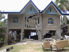 """<div class=""""source""""></div><div class=""""image-desc"""">The house picture is that Elma Simpson and her husband, Timothy, built in the Philippines. Her parents were living in the house when the earthquake hit Bohol in October. </div><div class=""""buy-pic""""></div>"""