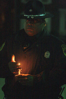 "<div class=""source"">Stephen Lega</div><div class=""image-desc"">Lebanon Police Officer Henry Keene is one of many law enforcement officers on hand to remember the late Marion County Sheriff's Deputy Anthony Rakes. </div><div class=""buy-pic""><a href=""http://web2.lcni5.com/cgi-bin/c2newbuyphoto.cgi?pub=015&orig=11-20-13_rakes_vigil-pic_10.jpg"" target=""_new"">Buy this photo</a></div>"