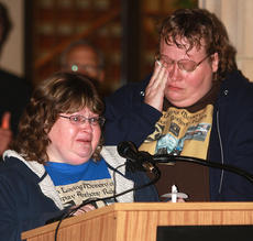 "<div class=""source"">Stephen Lega</div><div class=""image-desc"">Anita Elder, left, thanks the community for their support since her brother Marion County Sheriff's Deputy Anthony Rakes was killed. Her sister, Regina Ewing, stands beside her. </div><div class=""buy-pic""><a href=""http://web2.lcni5.com/cgi-bin/c2newbuyphoto.cgi?pub=015&orig=11-20-13_rakes_vigil-pic_11.jpg"" target=""_new"">Buy this photo</a></div>"