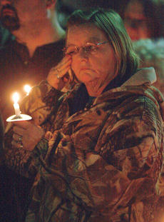 "<div class=""source"">Stephen Lega</div><div class=""image-desc"">Kathy Ewing wipes away a tear during the candlelight vigil. </div><div class=""buy-pic""><a href=""http://web2.lcni5.com/cgi-bin/c2newbuyphoto.cgi?pub=015&orig=11-20-13_rakes_vigil-pic_12.jpg"" target=""_new"">Buy this photo</a></div>"