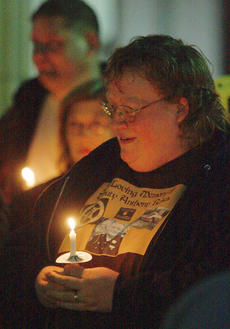 "<div class=""source"">Stephen Lega</div><div class=""image-desc"">Regina Ewing joined hundreds of people for a candlelight vigil Nov. 14 to remember her brother, Anthony Rakes, a sheriff's deputy who was killed one year ago. </div><div class=""buy-pic""><a href=""http://web2.lcni5.com/cgi-bin/c2newbuyphoto.cgi?pub=015&orig=11-20-13_rakes_vigil-pic_2.jpg"" target=""_new"">Buy this photo</a></div>"