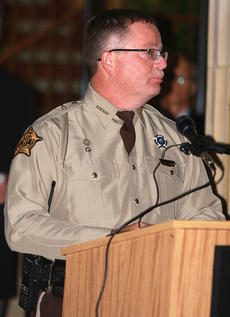 "<div class=""source"">Stephen Lega</div><div class=""image-desc"">Marion County Sheriff Jimmy Clements thanks the community for its support since Deputy Anthony Rakes was killed one year ago. </div><div class=""buy-pic""><a href=""http://web2.lcni5.com/cgi-bin/c2newbuyphoto.cgi?pub=015&orig=11-20-13_rakes_vigil-pic_4.jpg"" target=""_new"">Buy this photo</a></div>"