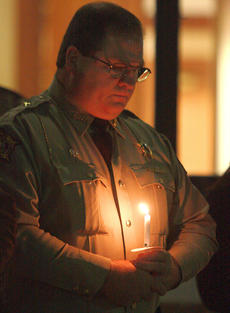 "<div class=""source"">Stephen Lega</div><div class=""image-desc"">Marion County Sheriff's Deputy Ray Gardner holds a candle to remember his fallen colleague. </div><div class=""buy-pic""><a href=""http://web2.lcni5.com/cgi-bin/c2newbuyphoto.cgi?pub=015&orig=11-20-13_rakes_vigil-pic_6.jpg"" target=""_new"">Buy this photo</a></div>"