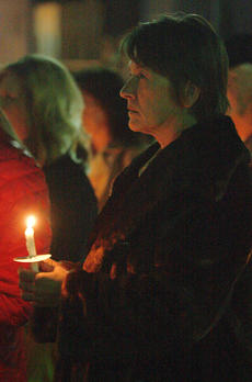 "<div class=""source"">Stephen Lega</div><div class=""image-desc"">Debbie Higdon of the Marion County Sheriff's Office honor Rakes' memory during last week's candlelight vigil. </div><div class=""buy-pic""><a href=""http://web2.lcni5.com/cgi-bin/c2newbuyphoto.cgi?pub=015&orig=11-20-13_rakes_vigil-pic_8.jpg"" target=""_new"">Buy this photo</a></div>"