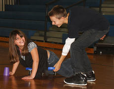 """<div class=""""source"""">Stevie Lowery</div><div class=""""image-desc"""">Selena Cepeda and Bryce Spalding participate in a scooter stacking challenge.</div><div class=""""buy-pic""""><a href=""""http://web2.lcni5.com/cgi-bin/c2newbuyphoto.cgi?pub=015&orig=11-23-11%2BGES%2Bcup%2Bstacking%2B2.jpg"""" target=""""_new"""">Buy this photo</a></div>"""