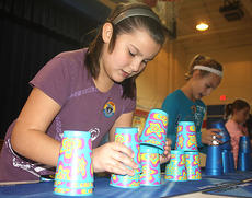 """<div class=""""source"""">Stevie Lowery</div><div class=""""image-desc"""">Skylar Maddox and Gretchen Walston race against the clock in a stacking challenge.</div><div class=""""buy-pic""""><a href=""""http://web2.lcni5.com/cgi-bin/c2newbuyphoto.cgi?pub=015&orig=11-23-11%2BGES%2Bcup%2Bstacking%2B3.jpg"""" target=""""_new"""">Buy this photo</a></div>"""