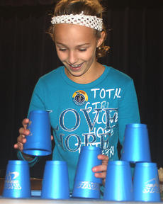 """<div class=""""source"""">Stevie Lowery</div><div class=""""image-desc"""">Gretchen Walston races against the clock during a stacking challenge.</div><div class=""""buy-pic""""><a href=""""http://web2.lcni5.com/cgi-bin/c2newbuyphoto.cgi?pub=015&orig=11-23-11%2BGES%2Bcup%2Bstacking%2B4.jpg"""" target=""""_new"""">Buy this photo</a></div>"""