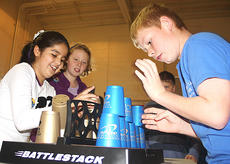 """<div class=""""source"""">Stevie Lowery</div><div class=""""image-desc"""">Fernanda Reyes and Dakota Pinkston compete against each other during a stacking challenge. Also pictured are CeAnna Gordon and Jackson Martin.</div><div class=""""buy-pic""""><a href=""""http://web2.lcni5.com/cgi-bin/c2newbuyphoto.cgi?pub=015&orig=11-23-11%2BGES%2Bcup%2Bstacking%2B6.jpg"""" target=""""_new"""">Buy this photo</a></div>"""