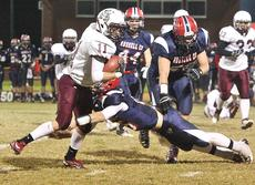 "<div class=""source"">Jessica Veatch</div><div class=""image-desc"">Senior Cameron Brown makes a Russell County tackler miss to gain more yards in a running play in the playoff game Friday night.</div><div class=""buy-pic""></div>"