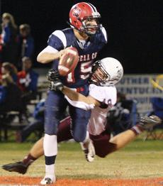 "<div class=""source"">Jessica Veatch</div><div class=""image-desc"">Junior Jack Hagan sacks the quarterback in the loss to Russell County Friday night in the playoffs.</div><div class=""buy-pic""><a href=""http://web2.lcni5.com/cgi-bin/c2newbuyphoto.cgi?pub=015&orig=11-7%2Bfootball%2B75.jpg"" target=""_new"">Buy this photo</a></div>"