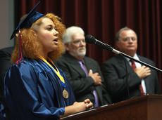 """<div class=""""source"""">Stephen Lega</div><div class=""""image-desc"""">Morgan Bell sings the national anthem to open the graduation ceremony. School board members Ed Hacker and Mike Cecil are in the background.</div><div class=""""buy-pic""""><a href=""""http://web2.lcni5.com/cgi-bin/c2newbuyphoto.cgi?pub=015&orig=12%2Bgraduation-anthem.jpg"""" target=""""_new"""">Buy this photo</a></div>"""