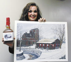 "<div class=""source"">The Kentucky Standard</div><div class=""image-desc"">Oil painter and landscape artist Mary Hagy is pictured with a Maker's Mark bottle, which features her painting of a winter scene at the Maker's Mark Distillery in Loretto.</div><div class=""buy-pic""></div>"