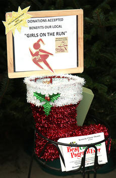 """<div class=""""source"""">Stevie Lowery</div><div class=""""image-desc"""">Santa Claus offers his services for free on Main Street, but he gladly accepts donations for the Marion County Girls on the Run program. Santa is one of the biggest supporters of Girls on the Run.</div><div class=""""buy-pic""""><a href=""""http://web2.lcni5.com/cgi-bin/c2newbuyphoto.cgi?pub=015&orig=12-16-15_santa_interview_5.jpg"""" target=""""_new"""">Buy this photo</a></div>"""