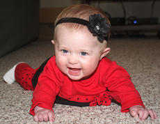 "<div class=""source"">Stevie Lowery</div><div class=""image-desc"">The H.A.N.D.S. program focuses on the importance of tummy time, which helps with a child's development. Initially, Brylee didn't like belly time. But now, at 5 months old, she loves it. </div><div class=""buy-pic""><a href=""/photo_select/31758"">Buy this photo</a></div>"
