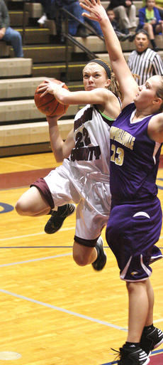 "<div class=""source"">Jessica Veatch</div><div class=""image-desc"">Junior Colleen Rakes puts up a tough shot against a Campbellsville defender in the game on Dec. 17 at the Roby Dome. </div><div class=""buy-pic""><a href=""http://web2.lcni5.com/cgi-bin/c2newbuyphoto.cgi?pub=015&orig=12-26%2Blady%2Bknights%2B56.jpg"" target=""_new"">Buy this photo</a></div>"