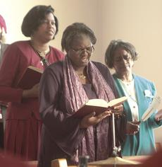 "<div class=""source"">Stephen Lega</div><div class=""image-desc"">Members of the choir lead the congregation in song. Pictured are Cheryl Body (left), Frances Gunn (center) and Alberta Bean.</div><div class=""buy-pic""><a href=""http://web2.lcni5.com/cgi-bin/c2newbuyphoto.cgi?pub=015&orig=12-29-10%2Bweb%2Bfirst%2Bbaptist%2Bpic%2B3.jpg"" target=""_new"">Buy this photo</a></div>"