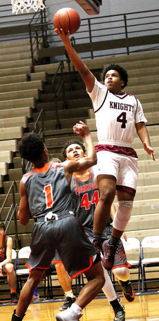 """<div class=""""source"""">Gerard Flanagan</div><div class=""""image-desc"""">Trevor Douglas ties the game against Frankfort Saturday at 40 apiece before halftime with this shot. Douglas finished with 12 points in the game.</div><div class=""""buy-pic""""><a href=""""/photo_select/54220"""">Buy this photo</a></div>"""