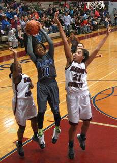"""<div class=""""source"""">Will Phillips</div><div class=""""image-desc"""">Senior teammates Alexus Calhoun (right) and Timera Burton (left) come together to defend North Hardin sophomore Tamiah Stanford (middle).</div><div class=""""buy-pic""""><a href=""""http://web2.lcni5.com/cgi-bin/c2newbuyphoto.cgi?pub=015&orig=2-19_girls_bball_pic_2.jpg"""" target=""""_new"""">Buy this photo</a></div>"""