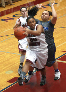 """<div class=""""source"""">Will Phillips</div><div class=""""image-desc"""">Freshman forward TeTe Adams goes up for a lay up on Sunday against North Hardin.</div><div class=""""buy-pic""""><a href=""""http://web2.lcni5.com/cgi-bin/c2newbuyphoto.cgi?pub=015&orig=2-19_girls_bball_pic_6.jpg"""" target=""""_new"""">Buy this photo</a></div>"""