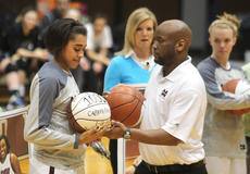 """<div class=""""source"""">Nick Schrager</div><div class=""""image-desc"""">During last week's senior night ceremony, Lady Knight senior Alexus Calhoun is presented with the ball she used to score her1,000th career point by her coach, Anthony Epps.</div><div class=""""buy-pic""""><a href=""""/photo_select/32704"""">Buy this photo</a></div>"""