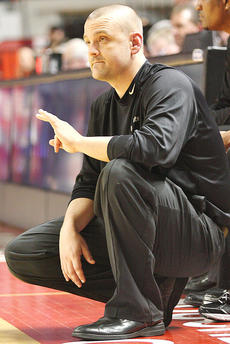"""<div class=""""source"""">Jessica Veatch</div><div class=""""image-desc"""">Head Coach Trent Milby calls out a play to the Lady Knights during the championship game against Manual.</div><div class=""""buy-pic""""><a href=""""http://web2.lcni5.com/cgi-bin/c2newbuyphoto.cgi?pub=015&orig=3-14%2Blady%2Bknights%2Bstate%2Btourney%2B216.jpg"""" target=""""_new"""">Buy this photo</a></div>"""