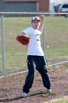 """<div class=""""source"""">Jessica Veatch</div><div class=""""image-desc"""">Sophomore Devin Spalding warms up before getting ready to pitch at a recent practice. He is expected to be the leader of the outfield and also have pitching duties this season.</div><div class=""""buy-pic""""><a href=""""/photo_select/10801"""">Buy this photo</a></div>"""