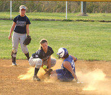 """<div class=""""source"""">Photo by Jessica Veatch</div><div class=""""image-desc"""">Senior shortstop Allison Mattingly attempts to tag out a Clinton County runner as she stole second base.  Senior centerfielder Tiffany Sapp backs up the play.</div><div class=""""buy-pic""""><a href=""""/photo_select/11306"""">Buy this photo</a></div>"""