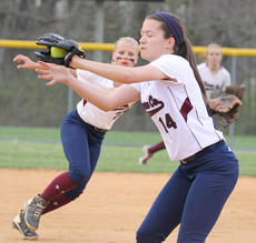 """<div class=""""source"""">Nick Schrager</div><div class=""""image-desc"""">Freshman pitcher Allison Maupin catches a line drive in a win over Elizabethtown. Also shown is junior shortstop Taylor Wade.  </div><div class=""""buy-pic""""><a href=""""http://web2.lcni5.com/cgi-bin/c2newbuyphoto.cgi?pub=015&orig=4-23_softball_pic_4.jpg"""" target=""""_new"""">Buy this photo</a></div>"""