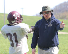 "<div class=""source"">Nick Schrager</div><div class=""image-desc"">Coach Jeremy Maquire talks with sophomore linebacker Gregory Litsey.</div><div class=""buy-pic""><a href=""/photo_select/34057"">Buy this photo</a></div>"