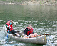 """<div class=""""source""""></div><div class=""""image-desc""""> Jon Hillman and Kendall Lupachino have fun canoeing at 4H camp.</div><div class=""""buy-pic""""></div>"""