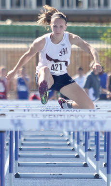 """<div class=""""source"""">Nick Schrager</div><div class=""""image-desc"""">Meredith Bartley nears the end of the girls 100 meter hurdles.</div><div class=""""buy-pic""""><a href=""""/photo_select/34689"""">Buy this photo</a></div>"""