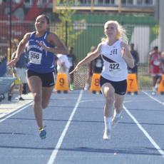 """<div class=""""source"""">Nick Schrager</div><div class=""""image-desc"""">Miranda Bradshaw tries to pass Spencer County's Kaylan Nigh in a 100-meter heat. </div><div class=""""buy-pic""""><a href=""""/photo_select/34691"""">Buy this photo</a></div>"""