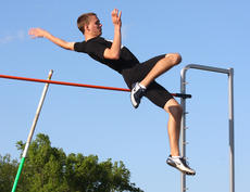 """<div class=""""source"""">Photo by Jessica Veatch</div><div class=""""image-desc"""">Sophomore Brooks Divine clears the pole during the pole vault event at the home track meet Thursday.</div><div class=""""buy-pic""""><a href=""""http://web2.lcni5.com/cgi-bin/c2newbuyphoto.cgi?pub=015&orig=5-4%2Btrack%2Bmeets%2B128_0.jpg"""" target=""""_new"""">Buy this photo</a></div>"""
