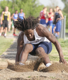 """<div class=""""source"""">Nick Schrager</div><div class=""""image-desc"""">Wet sand flies as Samaad Bouie makes a landing in the long jump at the Danville All-Comers Meet. </div><div class=""""buy-pic""""><a href=""""/photo_select/34242"""">Buy this photo</a></div>"""