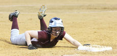 "<div class=""source"">Photo by Jessica Veatch</div><div class=""image-desc"">Junior Emily Fenwick slides safely into third base in the game against Taylor County.</div><div class=""buy-pic""><a href=""http://web2.lcni5.com/cgi-bin/c2newbuyphoto.cgi?pub=015&orig=6-1%2Bsoftball%2Bstory%2B62.jpg"" target=""_new"">Buy this photo</a></div>"