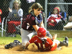 "<div class=""source"">Photo by Jessica Veatch</div><div class=""image-desc"">Junior Coco May attempts to tag a runner out at home after receiving a throw from left fielder Casey Jo Walls.  The Lady Knights lost the district game against Taylor County by a final score of 12-7.</div><div class=""buy-pic""><a href=""http://web2.lcni5.com/cgi-bin/c2newbuyphoto.cgi?pub=015&orig=6-1%2Bsoftball%2Bstory%2B99.jpg"" target=""_new"">Buy this photo</a></div>"