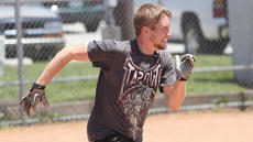 """<div class=""""source"""">Nick Schrager</div><div class=""""image-desc"""">Adam Swallows runs with all his might to first base.</div><div class=""""buy-pic""""><a href=""""/photo_select/35037"""">Buy this photo</a></div>"""