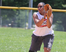 """<div class=""""source"""">Nick Schrager</div><div class=""""image-desc"""">Melissa Young catches a ball hit to the infield.</div><div class=""""buy-pic""""><a href=""""/photo_select/35038"""">Buy this photo</a></div>"""