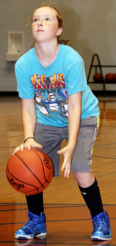 """<div class=""""source"""">Nick Schrager</div><div class=""""image-desc"""">Multiples tasks at once can be tricky, but by the looks of it, Brooke Smith is on top of dribbling the ball while planning her free throw. </div><div class=""""buy-pic""""><a href=""""http://web2.lcni5.com/cgi-bin/c2newbuyphoto.cgi?pub=015&orig=6-26%2Bbball%2Bcamp%2B10.jpg"""" target=""""_new"""">Buy this photo</a></div>"""