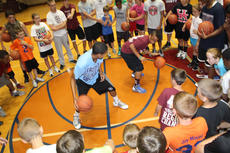 """<div class=""""source"""">Nick Schrager</div><div class=""""image-desc"""">Surrounded by many in attendance, Jamison Epps and Nathaniel Gribbins duke it out dribble style as their peers roared and cackled at the basketball camp at last week at Marion County High School.</div><div class=""""buy-pic""""><a href=""""http://web2.lcni5.com/cgi-bin/c2newbuyphoto.cgi?pub=015&orig=6-26%2Bbball%2Bcamp%2B6.jpg"""" target=""""_new"""">Buy this photo</a></div>"""