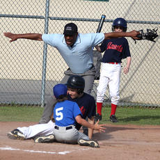 "<div class=""source"">Nick Schrager</div><div class=""image-desc"">Umpire Tony Coleman calls a runner safe during a recent game at Graham Memorial Park. Coleman returned to the diamond after suffering a heart attack.  </div><div class=""buy-pic""><a href=""http://web2.lcni5.com/cgi-bin/c2newbuyphoto.cgi?pub=015&orig=6-26%2Bumpire%2Bfeature%2B1.jpg"" target=""_new"">Buy this photo</a></div>"