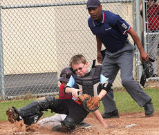 """<div class=""""source"""">Photo by Jessica Veatch</div><div class=""""image-desc"""">Cardinals catcher Brandon Lee attempts to tag out an Astros runner sliding into  home plate.</div><div class=""""buy-pic""""><a href=""""/photo_select/12489"""">Buy this photo</a></div>"""