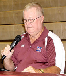 "<div class=""source"">Jessica Veatch</div><div class=""image-desc"">Since 1987, Jerry Reynolds has been announcing games for the Marion County Knights basketball team.</div><div class=""buy-pic""><a href=""/photo_select/21352"">Buy this photo</a></div>"