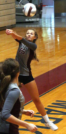 """<div class=""""source"""">Gerard Flanagan</div><div class=""""image-desc"""">Middle hitter Sarah Clark gets under the ball during Marion County's scrimmage on Aug. 10 against Bardstown at the Roby Dome. </div><div class=""""buy-pic""""><a href=""""/photo_select/57300"""">Buy this photo</a></div>"""