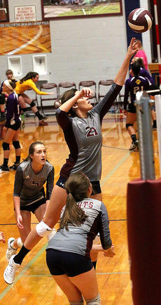 """<div class=""""source"""">Gerard Flanagan</div><div class=""""image-desc"""">Senior Callie Gribbins tips the ball over the net during the Lady Knights' scrimmage on Aug. 10 against Bardstown at the Roby Dome. </div><div class=""""buy-pic""""><a href=""""/photo_select/57301"""">Buy this photo</a></div>"""
