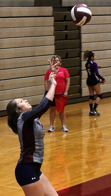 """<div class=""""source"""">Gerard Flanagan</div><div class=""""image-desc"""">Senior Isabella Glasscock gets under the ball during Marion County's scrimmage on Aug. 10 against Bardstown at the Roby Dome. </div><div class=""""buy-pic""""><a href=""""/photo_select/57303"""">Buy this photo</a></div>"""