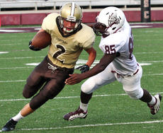"<div class=""source"">Jessica Veatch</div><div class=""image-desc"">Junior Samaad Bouie prepares to tackle an Evansville Central player Saturday in the 2012 Forcht Bank Bowl.</div><div class=""buy-pic""><a href=""http://web2.lcni5.com/cgi-bin/c2newbuyphoto.cgi?pub=015&orig=8-22%2Bfootball%2B141.jpg"" target=""_new"">Buy this photo</a></div>"