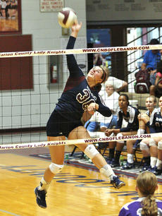 """<div class=""""source""""></div><div class=""""image-desc"""">Junior Abby Murphy attempts a kill in the match against Campbellsville on Aug. 13. The Lady Knights won in three straight sets.</div><div class=""""buy-pic""""><a href=""""/photo_select/22084"""">Buy this photo</a></div>"""
